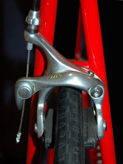 front handbrake on a red bicycle